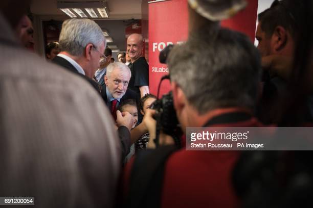 Labour leader Jeremy Corbyn poses for photographs with children after delivering a speech on Brexit at the Pitsea Leisure Centre while on the General...