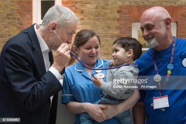 Labour leader Jeremy Corbyn pretends to use a stethoscope with 2yearold Haroon after he met NHS nurses student nurses and midwives to discuss...