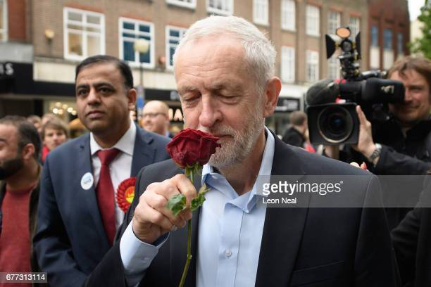 Labour leader Jeremy Corbyn smells a red rose as he attends a Labour Party general election campaign event on May 3 2017 in Bedford England The Prime...