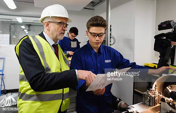 Labour leader Jeremy Corbyn speaks with an apprentice during a visit to the Science Technology Engineering and Maths further education college on...