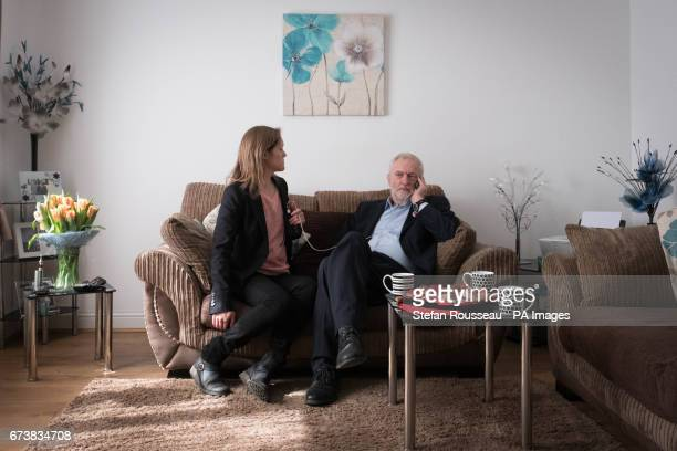 Labour leader Jeremy Corbyn takes a phone call in the home of Don and Marilyn Bashford who he visited after the couple were recently rehomed in a...