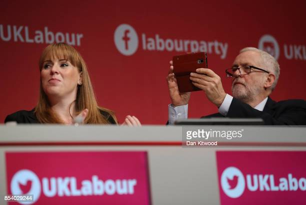 Labour Leader Jeremy Corbyn takes photographs during Shadow Secretary of State for Business Energy and Industrial Strategy Rebecca LongBailey's...