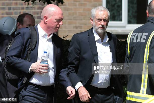 Labour leader Jeremy Corbyn visits the scene of the Grenfell Tower fire with Matt Wrack General Secretary of the Fire Brigades Union on June 15 2017...
