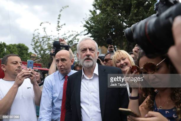 Labour leader Jeremy Corbyn visits the scene of the Grenfell Tower fire on June 15 2017 in London England At least 17 people have been confirmed dead...