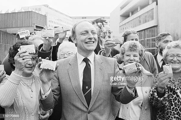 Labour leader Neil Kinnock distributes butter from the surplus known as the 'butter mountain' to a group of receptive ladies 2nd April 1984