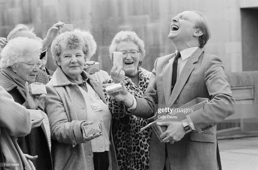 Labour leader <a gi-track='captionPersonalityLinkClicked' href=/galleries/search?phrase=Neil+Kinnock&family=editorial&specificpeople=178980 ng-click='$event.stopPropagation()'>Neil Kinnock</a> distributes butter from the surplus known as the 'butter mountain' to a group of receptive ladies, 2nd April 1984.