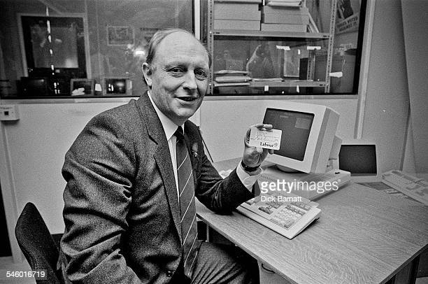 Labour leader Neil Kinnock holding his party membership card and sitting by a computer at the launch of the Labour Party Membership Campaign London...