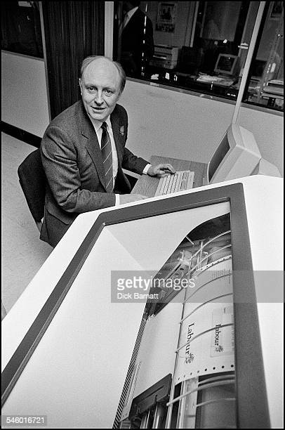 Labour leader Neil Kinnock sitting at a computer terminal at the launch of the Labour Party Membership Campaign London 1989