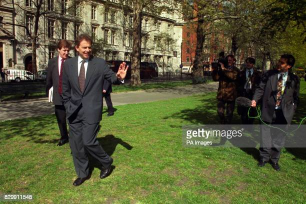 Labour leader Tony Blair and his press secretary Alastair Campbell are followed by the media as he walks through Westminster in London today where he...