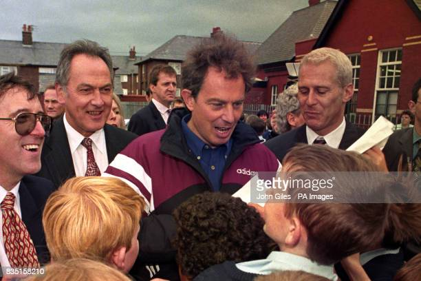 Labour leader Tony Blair centre with Jack Cunningham second left is mobbed by young schoolchildren during a visit to Devonshhire Road Primary School...