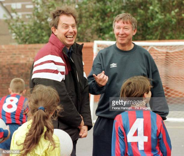 Labour leader Tony Blair enjoys a laugh with Manchester United manager Alex Ferguson during a visit today to Devonshire Road primary school in...
