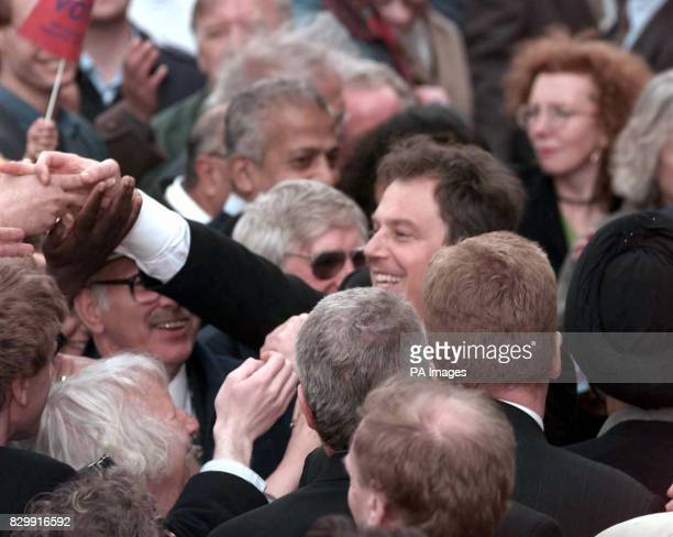 Labour leader Tony Blair reaches out to supporters after his soapbox speech in Leicester today See PA Story ELECTION Blair Photo by Sean Dempsey