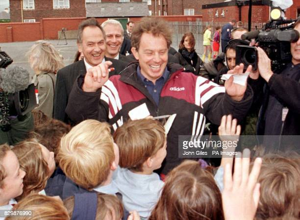 Labour leader Tony Blair with Jack Cunningham is mobbed by young schoolchildren during a visit today to Devonshire Road primary school in Blackpool...