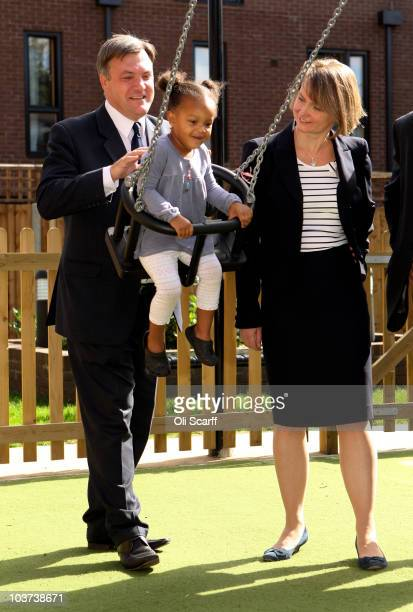 Labour leadership candidate Ed Balls and his wife Yvette Cooper the Shadow Work and Pensions Secretary push Eden aged 2 on a swing during a visit to...