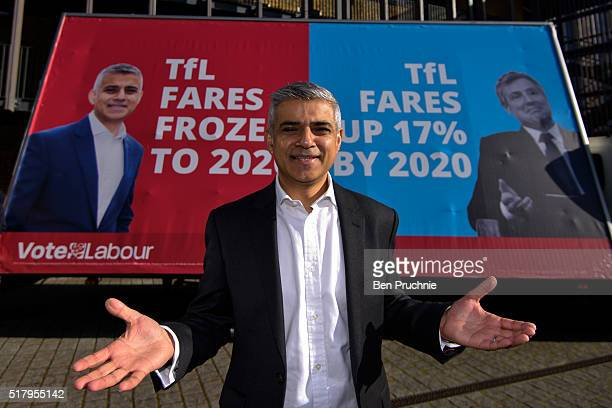 Labour Mayoral Candidate Sadiq Khan poses next to his new campaign poster on March 29 2016 in London England Sadiq Khan is currently one of the main...
