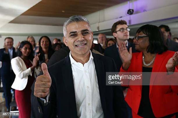 Labour Member of Parliament for Tooting and London mayoral candidate Sadiq Khan gestures after winning the contest to become Labour's candidate to...