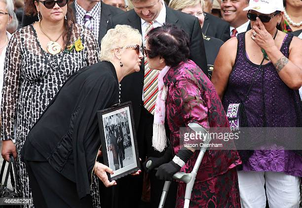 Labour MP Annette King carrying a 40yearold photo of former Prime Minister Norman Kirk at Waitangi and Titewhai Harawira exchange a kiss as they...