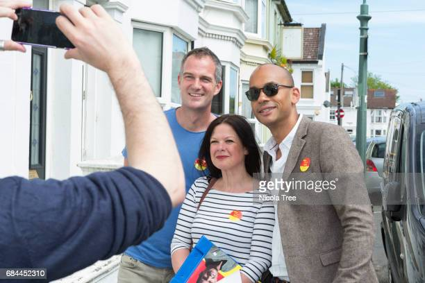 Labour MP Chuka Umunna poses for a photograph with local Labour candidate Peter Kyle as he campaigns and door knocks in the constituency on May 16...