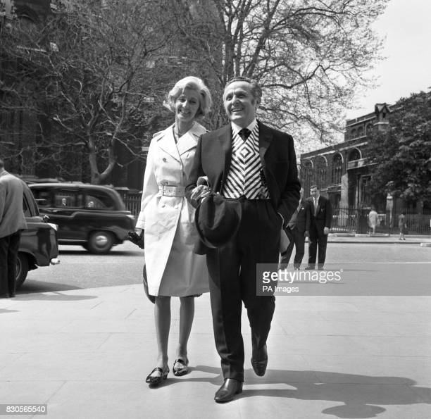 Labour MP for Pontypool Leo Abse who is conducting a oneman campaign to brighten up the House of Commons sartorially arriving with his wife at the...