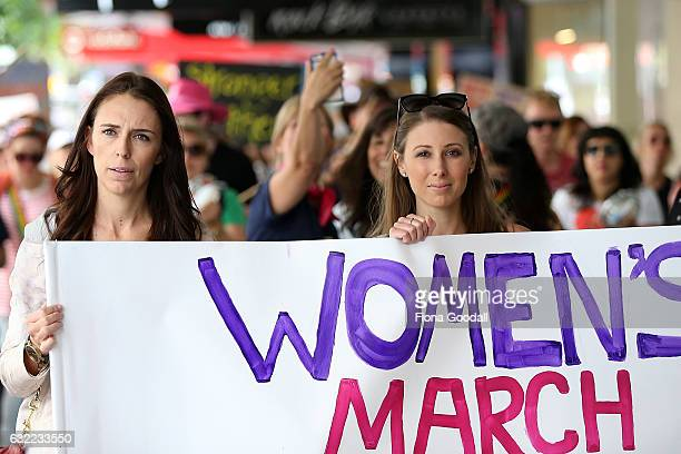 Labour MP Jacinda Ardern and musician writer activist Lizzie Marvelly join thousands of people marching up Queen Street on January 21 2017 in...