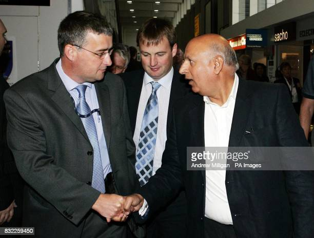 Labour MP Mohammed Sarwar shakes hands with Detective Inspector Gordon Greenlees while Western Isles Labour MSP Alasdair Morrison looks on at arrival...