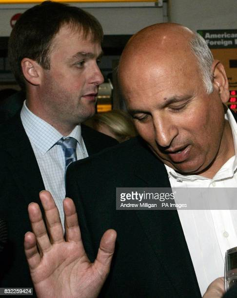 Labour MP Mohammed Sarwar walks with Western Isles Labour MSP Alasdair Morrison on their arrival at Glasgow Airport where they are to meet the mother...