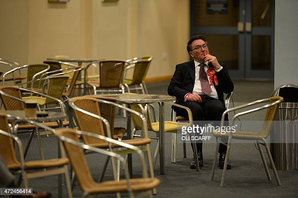 A Labour Party activist watches the results come in at the counting centre at Doncaster Racecourse northern England on May 8 2015 as votes are...