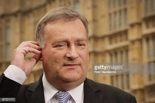 Labour Party Chief Whip Nick Brown adjusts his earpiece as he talks to reporters on May 14 2009 outside Parliament in London The Daily Telegraph has...