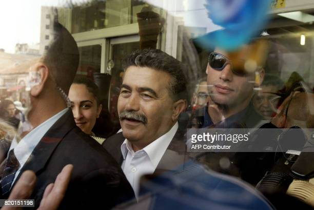 Labour party leader Amir Peretz is relected through the window of a shoe shop as he leaves during his election campaign tour in Jerusalem 21 March...