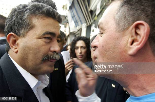 Labour party leader Amir Peretz listens to a supporter of the opposition during his election campaign tour of Jerusalem 21 March 2006 Israel's...