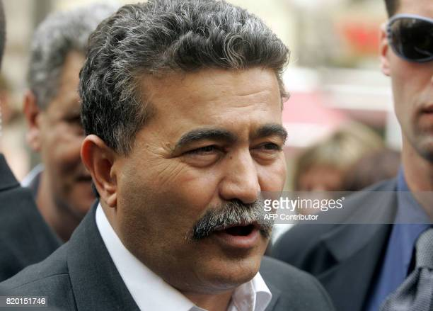 Labour party leader Amir Peretz speaks to Israeli pedestrians during his election campaign tour of Jerusalem 21 March 2006 Israel's general election...