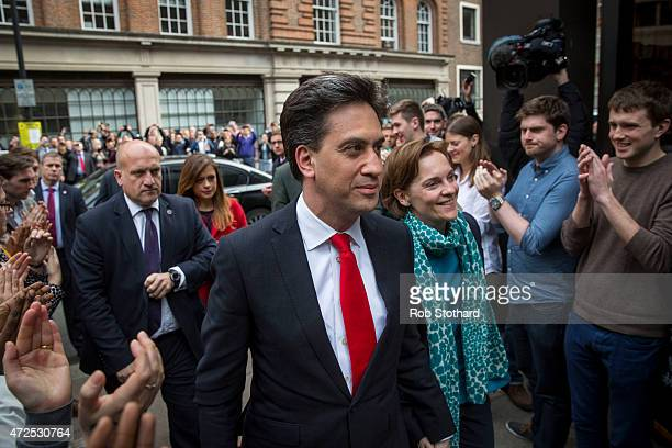 Labour Party leader Ed Miliband and his wife Justine Thornton are greeted by supporters at Labour party headquarters on May 8 2015 in London England...