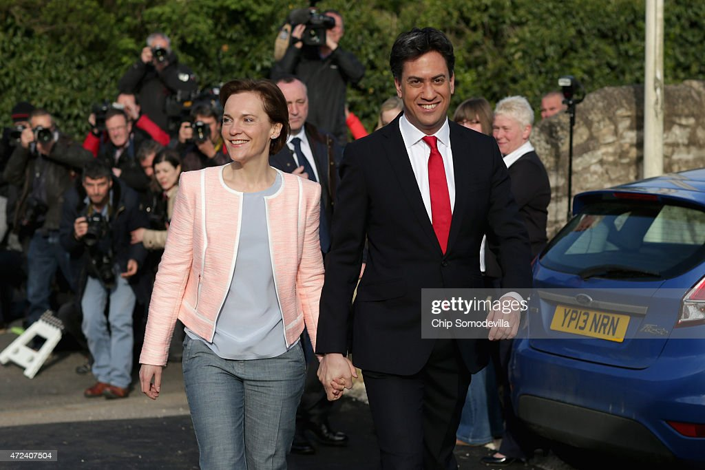 Labour Party leader Ed Miliband and his wife Justine Thornton arrive at the polling station at Sutton Village Hall in Sutton to cast their votes in the 2015 general election on May 7, 2015 in Doncaster, England. The United Kingdom has gone to the polls to vote for a new government in one of the most closely fought General Elections in recent history. With the result too close to call it is anticipated that there will be no overall clear majority winner and a coalition government will have to be formed once again.