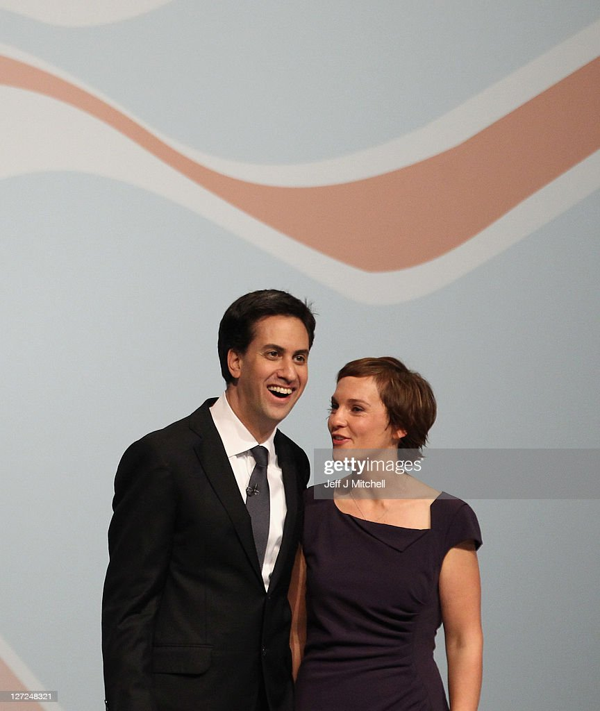 Labour party leader Ed Miliband and his wife Justine Thorton take applause after delivering his keynote speech to members and delegates during the annual Labour party conference at the Echo Arena on September 27, 2011 in Liverpool, England. It was Ed Miliband's most important speech since becoming Labour leader a year ago and focussed on Britain's 'fast buck' culture, set out his belief that hard workers should be rewarded, and also said 'Labour will always stand as the voice of the people, our people'.