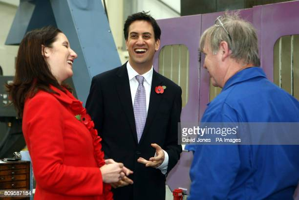 Labour Party leader Ed Miliband and Shadow Chief Secretary to the Treasury Rachel Reeves talk with Dave Pearson during a visit to Manthorpe...