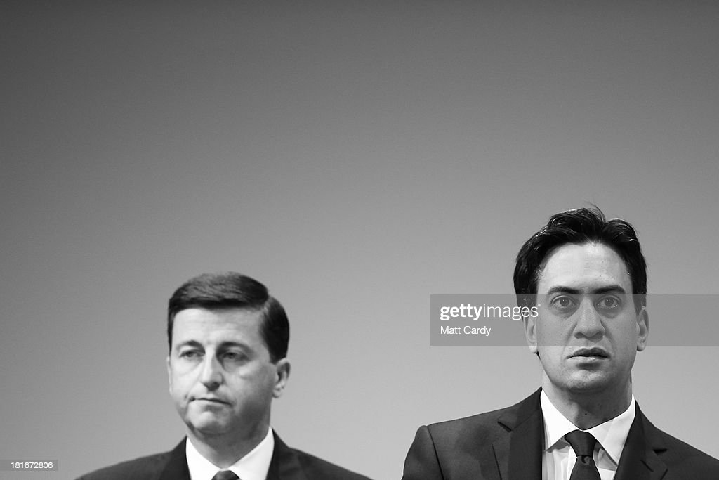 Labour Party leader <a gi-track='captionPersonalityLinkClicked' href=/galleries/search?phrase=Ed+Miliband&family=editorial&specificpeople=4376337 ng-click='$event.stopPropagation()'>Ed Miliband</a> (R) and Shadow Foreign Secretary <a gi-track='captionPersonalityLinkClicked' href=/galleries/search?phrase=Douglas+Alexander&family=editorial&specificpeople=616758 ng-click='$event.stopPropagation()'>Douglas Alexander</a> listen to speakers at the Labour Party conference on September 23, 2013 in Brighton, England. The opposition Labour Party are holding their annual conference in the southern English coastal town for the next four days.