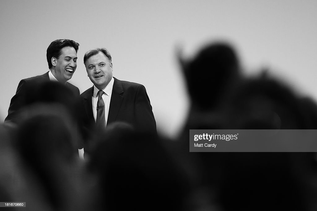Labour Party leader <a gi-track='captionPersonalityLinkClicked' href=/galleries/search?phrase=Ed+Miliband&family=editorial&specificpeople=4376337 ng-click='$event.stopPropagation()'>Ed Miliband</a> (L) congratulates Shadow Chancellor <a gi-track='captionPersonalityLinkClicked' href=/galleries/search?phrase=Ed+Balls&family=editorial&specificpeople=3244683 ng-click='$event.stopPropagation()'>Ed Balls</a> at the Labour Party conference on September 23, 2013 in Brighton, England. The opposition Labour Party are holding their annual conference in the southern English coastal town for the next four days.