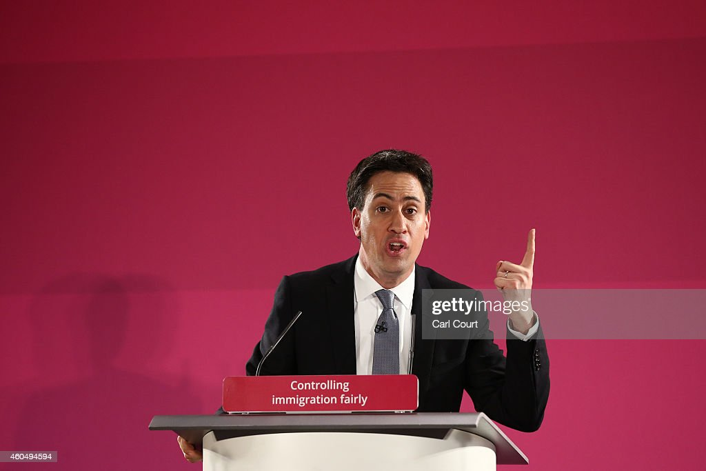 Labour party leader <a gi-track='captionPersonalityLinkClicked' href=/galleries/search?phrase=Ed+Miliband&family=editorial&specificpeople=4376337 ng-click='$event.stopPropagation()'>Ed Miliband</a> gestures during a speech on December 15, 2014 in Great Yarmouth, England. Miliband set out plans to stop cheap foreign workers replacing British staff, stating that a Labour government would pass a law to criminalise such behaviour.