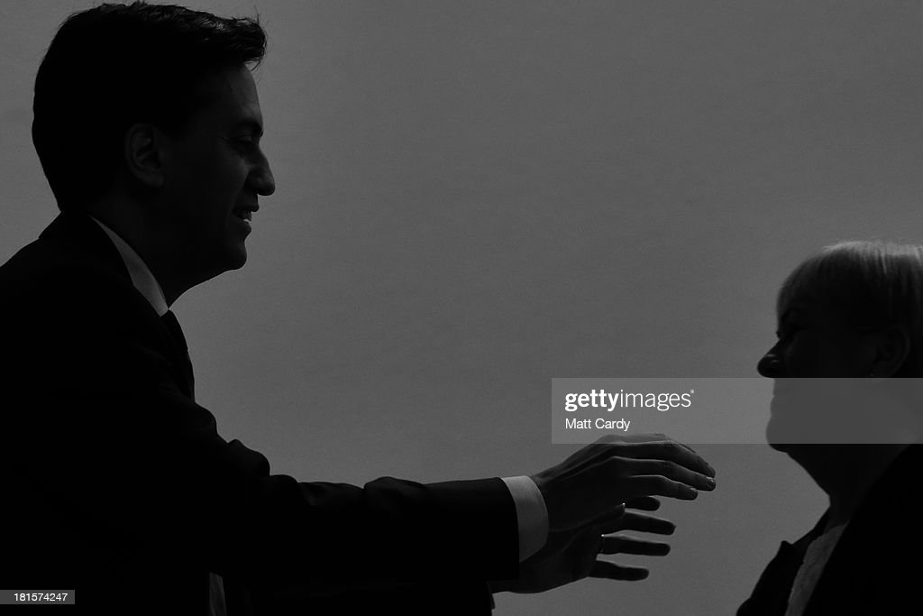 Labour party leader <a gi-track='captionPersonalityLinkClicked' href=/galleries/search?phrase=Ed+Miliband&family=editorial&specificpeople=4376337 ng-click='$event.stopPropagation()'>Ed Miliband</a> greets a speaker at the Labour Party conference on September 22, 2013 in Brighton, England. The opposition Labour Party are holding their annual conference in the southern English coastal town for the next four days..