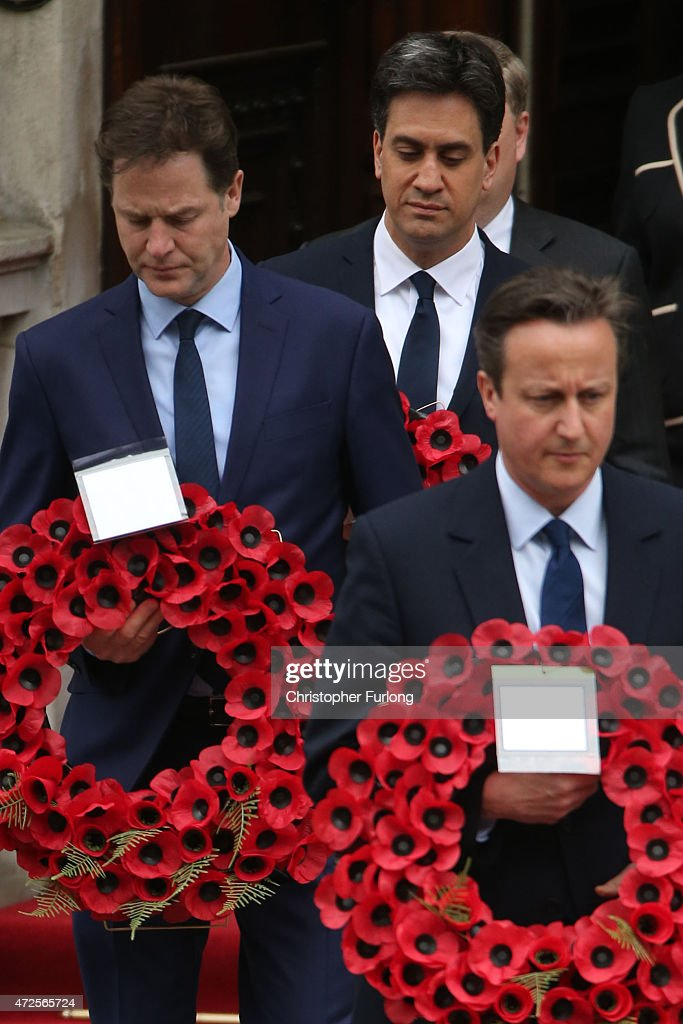 Labour Party leader Ed Miliband, Liberal Democrat leader Nick Clegg and Prime Minister David Cameron prepare to place a wreath during a tribute at the Cenotaph to begin three days of national commemorations to mark the 70th anniversary of VE Day on May 8, 2015 in London, England. Leaders of the United Kingdom are gathering together after the country went to the polls yesterday and voted to keep Conservative party leader David Cameron as Prime Minister. Great Britain now starts three days of national commemorations of street parties, concerts and other events across the country to remember the end of World War II in Europe.