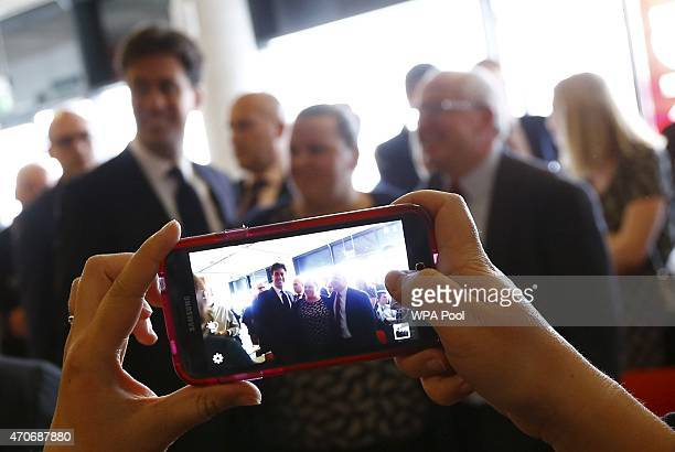 Labour Party leader Ed Miliband poses for photographs with supporters during a campaign event on April 22 2015 in Ipswich United Kingdom Britain goes...