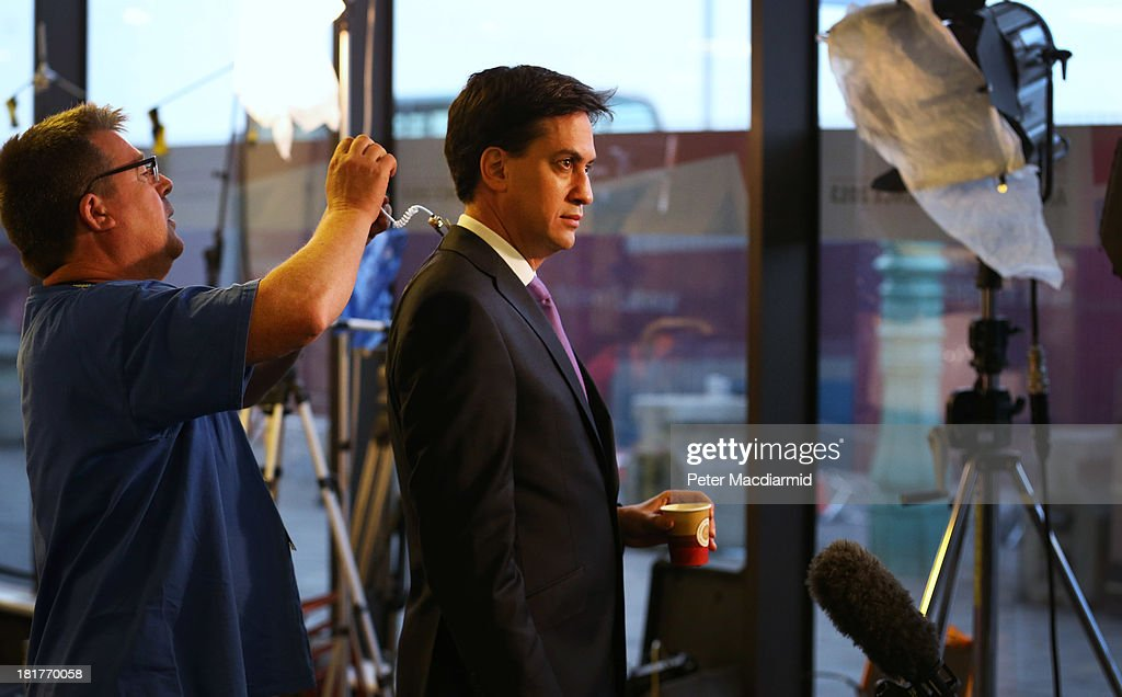 Labour Party leader <a gi-track='captionPersonalityLinkClicked' href=/galleries/search?phrase=Ed+Miliband&family=editorial&specificpeople=4376337 ng-click='$event.stopPropagation()'>Ed Miliband</a> prepares to give an early morning television interview at the Labour Party conference on September 25, 2013 in Brighton, England. Mr Miliband will take part in a question and answer session later on the last day of conference.
