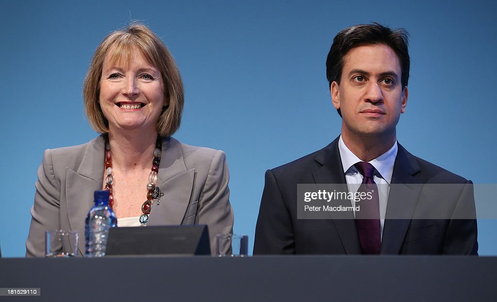 Labour party leader <a gi-track='captionPersonalityLinkClicked' href=/galleries/search?phrase=Ed+Miliband&family=editorial&specificpeople=4376337 ng-click='$event.stopPropagation()'>Ed Miliband</a> sits next to deputy party leader <a gi-track='captionPersonalityLinkClicked' href=/galleries/search?phrase=Harriet+Harman&family=editorial&specificpeople=839866 ng-click='$event.stopPropagation()'>Harriet Harman</a> at the Labour Party conference on September 22, 2013 in Brighton, England. The opposition Labour Party are holding their annual conference in the southern English coastal town for the next four days.
