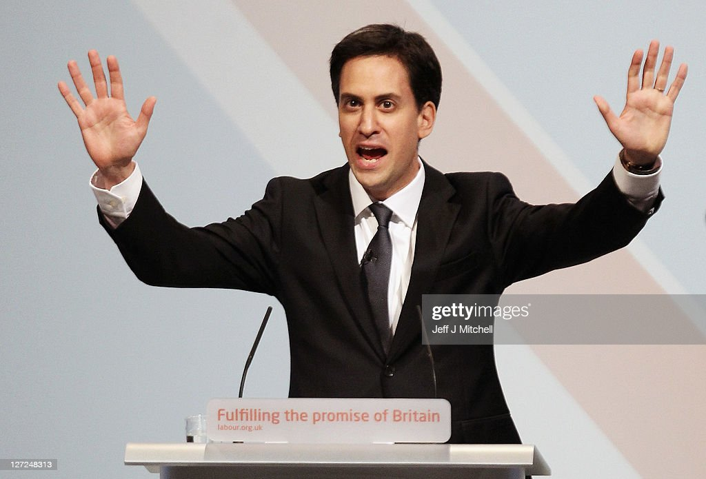 Labour party leader <a gi-track='captionPersonalityLinkClicked' href=/galleries/search?phrase=Ed+Miliband&family=editorial&specificpeople=4376337 ng-click='$event.stopPropagation()'>Ed Miliband</a>, takes applause before delivering his keynote speech to members and delegates during the annual Labour party conference at the Echo Arena on September 27, 2011 in Liverpool, England. It was <a gi-track='captionPersonalityLinkClicked' href=/galleries/search?phrase=Ed+Miliband&family=editorial&specificpeople=4376337 ng-click='$event.stopPropagation()'>Ed Miliband</a>'s most important speech since becoming Labour leader a year ago and focussed on Britain's 'fast buck' culture, set out his belief that hard workers should be rewarded, and also said 'Labour will always stand as the voice of the people, our people