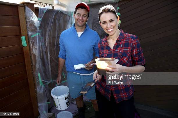 Labour party leader Jacinda Ardern and her partner Clarke Gayford pose as they paint the fence of their Pt Chevelier house on September 23 2017 in...