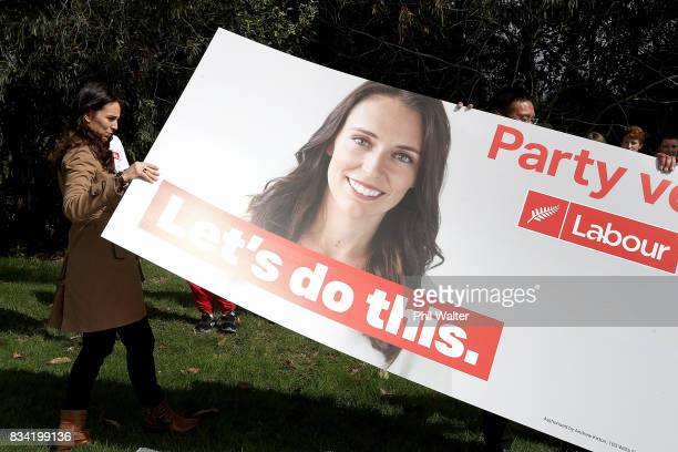 Labour Party leader Jacinda Ardern helps erect the new election campaign hoardings on August 18 2017 in Auckland New Zealand Labour will officially...