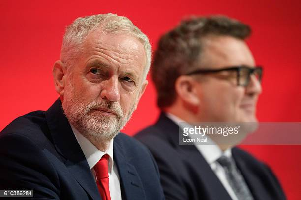 Labour party leader Jeremy Corbyn and Deputy leader Tom Watson sit in the main hall on the first day of the Labour Party Conference in the Exhibition...