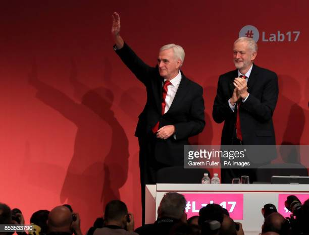Labour Party leader Jeremy Corbyn applauds after shadow chancellor John McDonnell delivered his speech at the Labour Party conference at the Brighton...