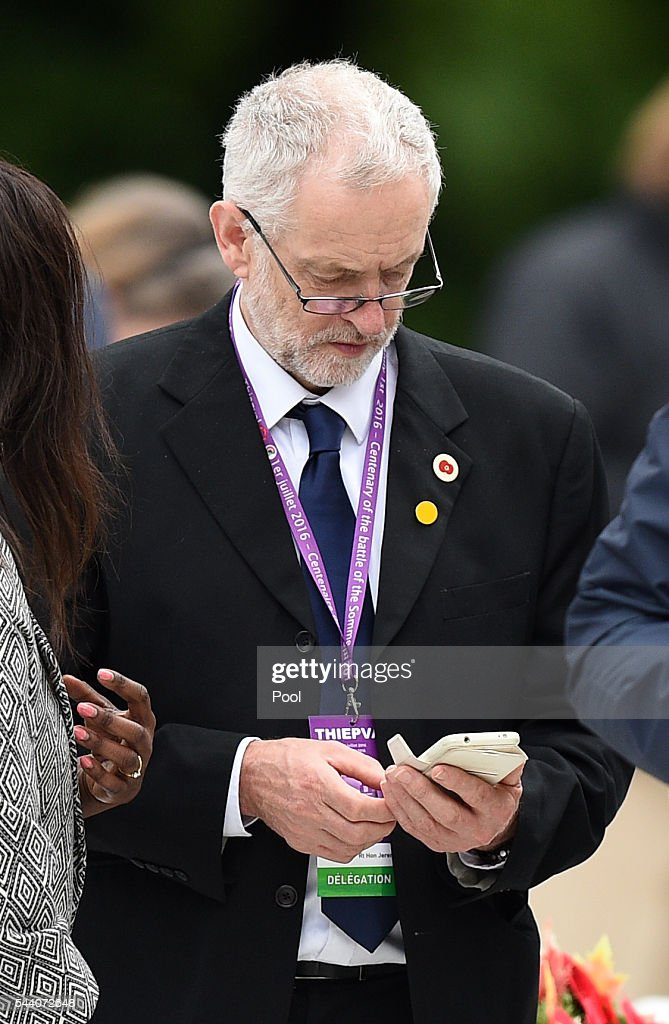 Labour Party leader <a gi-track='captionPersonalityLinkClicked' href=/galleries/search?phrase=Jeremy+Corbyn&family=editorial&specificpeople=2596361 ng-click='$event.stopPropagation()'>Jeremy Corbyn</a> checks his phone during the Commemoration of the Centenary of the Battle of the Somme at the Commonwealth War Graves Commission Thiepval Memorial on July 1, 2016 in Thiepval, France. The event is part of the Commemoration of the Centenary of the Battle of the Somme at the Commonwealth War Graves Commission Thiepval Memorial in Thiepval, France, where 70,000 British and Commonwealth soldiers with no known grave are commemorated.