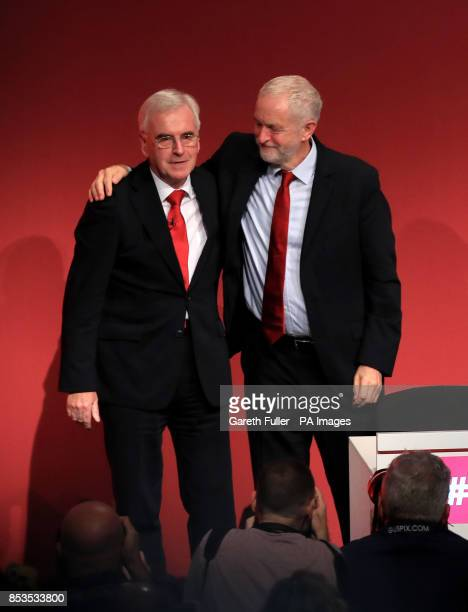 Labour Party leader Jeremy Corbyn congratulates shadow chancellor John McDonnell after his speech at the Labour Party conference at the Brighton...